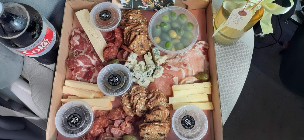 A generous spread of charcuterie cheeses and meats